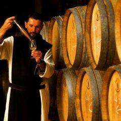 Monk tasting barrel sample